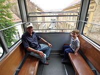 Riding the funicular to the upper town.